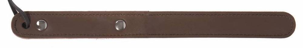 a skinny brown leather paddle