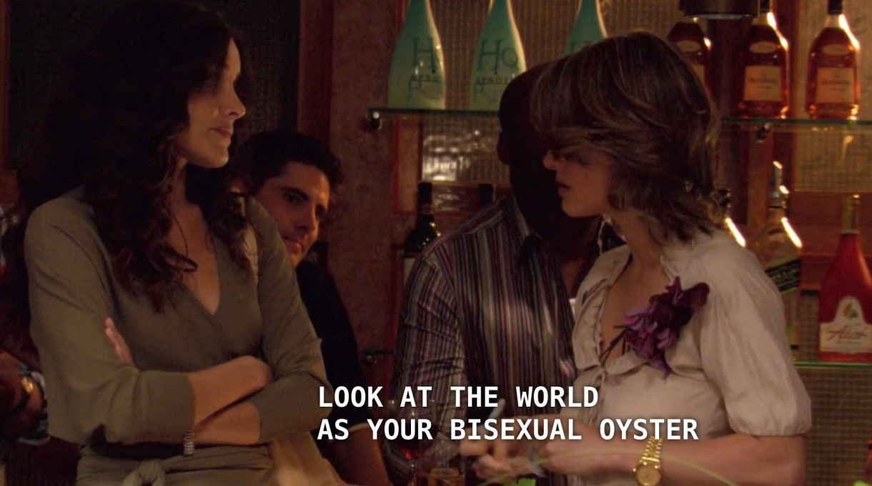 """Alice (wearing a white satin blouse) is trying to convince Helena (wearing an olive deep-v dress) to stay and try out Bisexual Speed Dating. Alice tells Helena, """"look at the world as your bisexual oyster."""""""