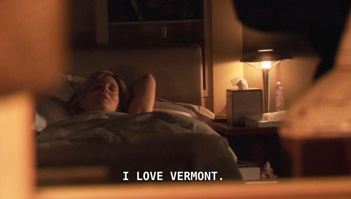 """Tina is laying in bed, her arms behind her head, looking at Bette off screen. Tina says, """"I love Vermont."""""""