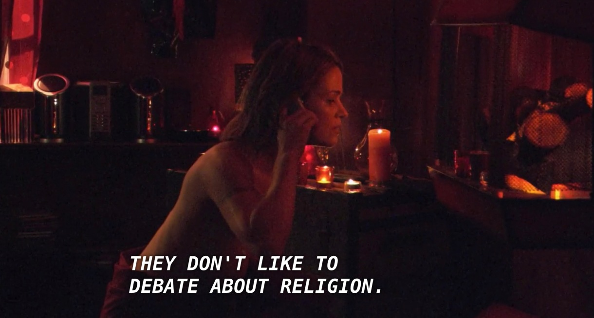 """Alice is talking on the phone in a room surrounded with candles. Helena says through the phone, referring to her research about vampires, """"they don't like to debate about religion."""""""