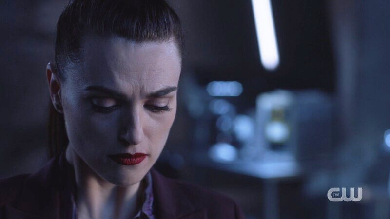 Lena looks down trying to fight her FEELINGS