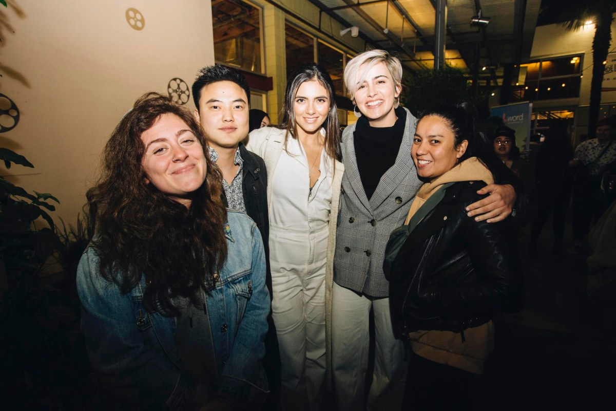 Two guests pose on either side of 3 of the members of Generation Q. From left to right: unnamed guest, Leo Sheng, Arienne Mandi, Jacqueline Toboni, and an unnamed guest.