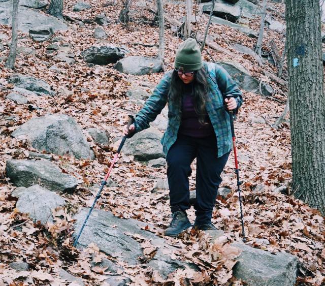 Vanessa hiking with poles.