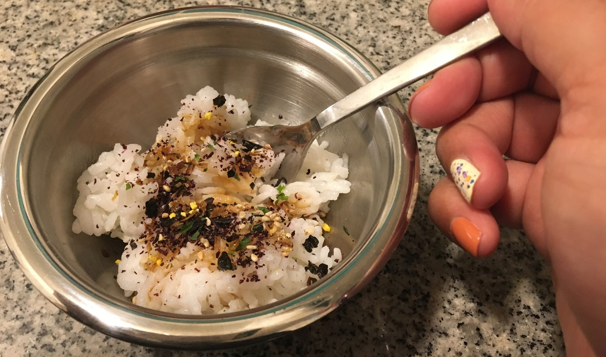 bowl of rice with toppings and spoon