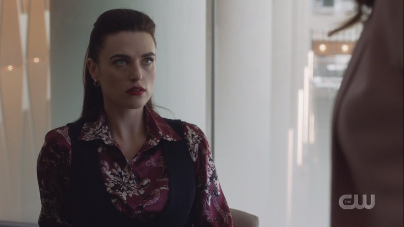 Lena considers her mother carefully while sitting fiercely