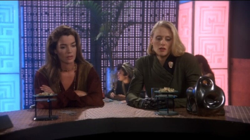 Susan Ivanova and Talia Winters. sit at a bar