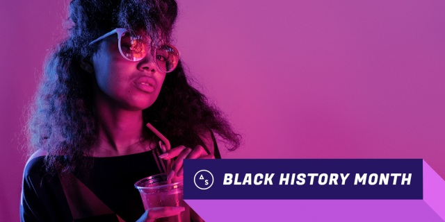 black history month autostraddle - young black woman wearing sunglasses holding cocktail with straw, looking at the camera in an appraising way