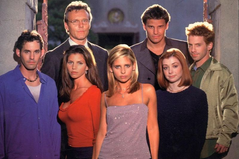 Image: a promotional photo of the cast of Buffy the Vampire Slayer: Xander, Cordelia, Giles, Buffy, Angel, Willow, Oz