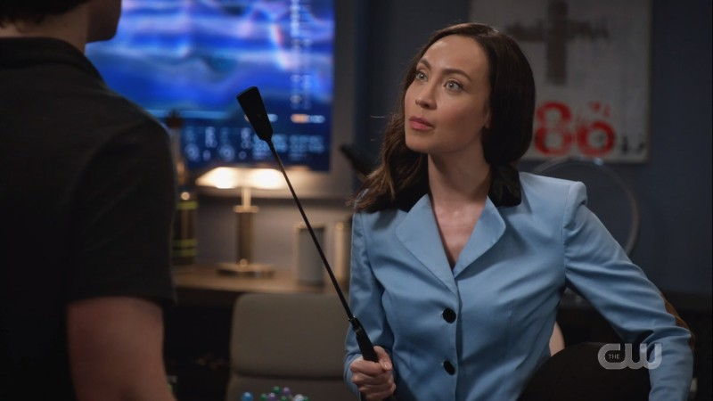 nora with a riding crop
