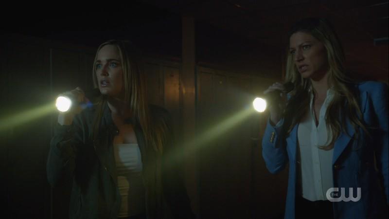 sara and ava stalk the halls with flashlights