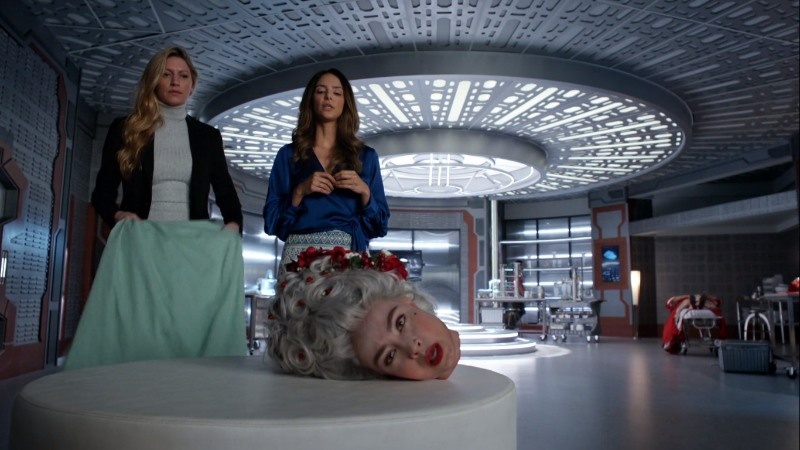ava and zari look at marie's sentient severed head