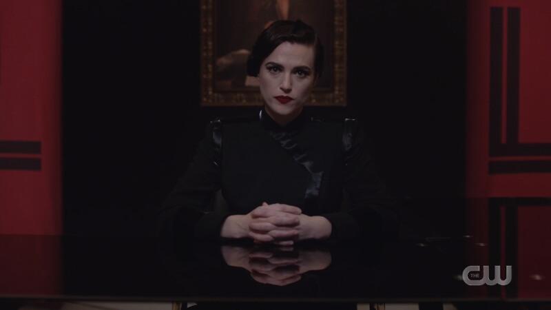 dark lena sits authoritatively