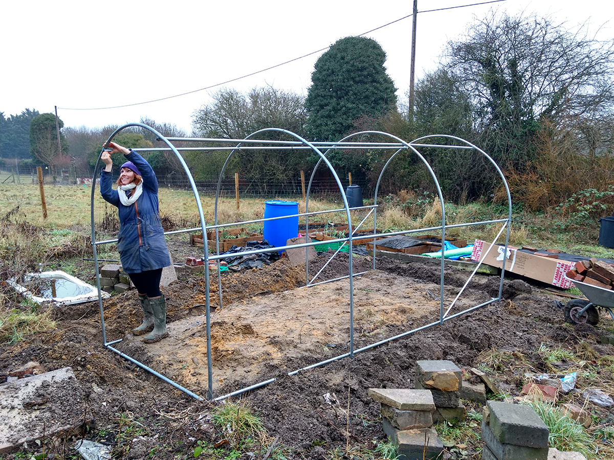 a lesbian putting a polytunnel together