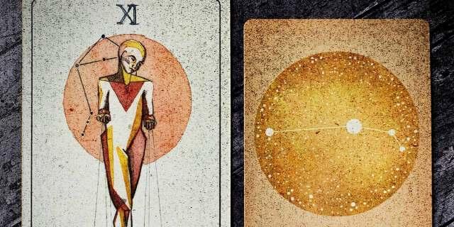 justice tarot card next to aries card