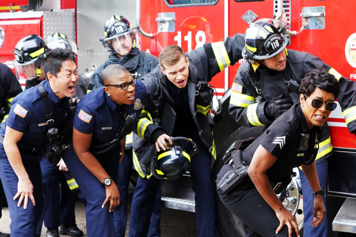 Image: The 9-1-1 team of first responders are grimacing from whatever it is they are all looking at. Everybody's faces are a real mixed bag to be honest. Angela Basset looks great as always. So does Hen, I love her. They're all in various uniforms.