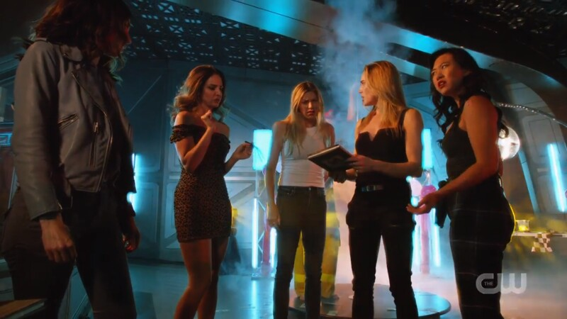 The girls look at the new book cover