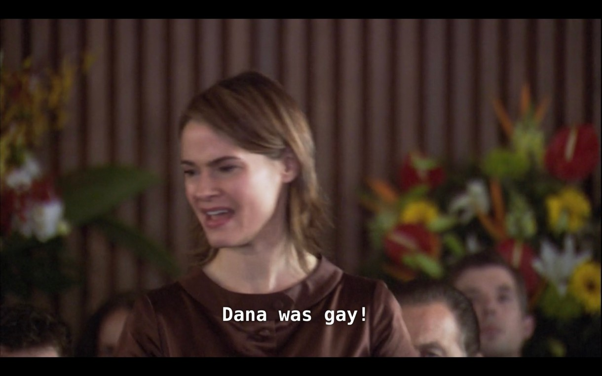 """Alice (notably wearing a brown dress at a funeral) stands up in the crowd at Dana's funeral service and yells, """"Dana was gay!"""""""