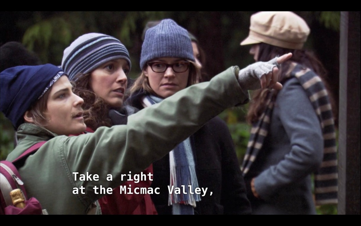 """Max, Bette, and Alice are preparing to go on a hike in Dana's memory. Max is pointing out in front of him and says, """"Take a right at the Micmac Valley"""""""
