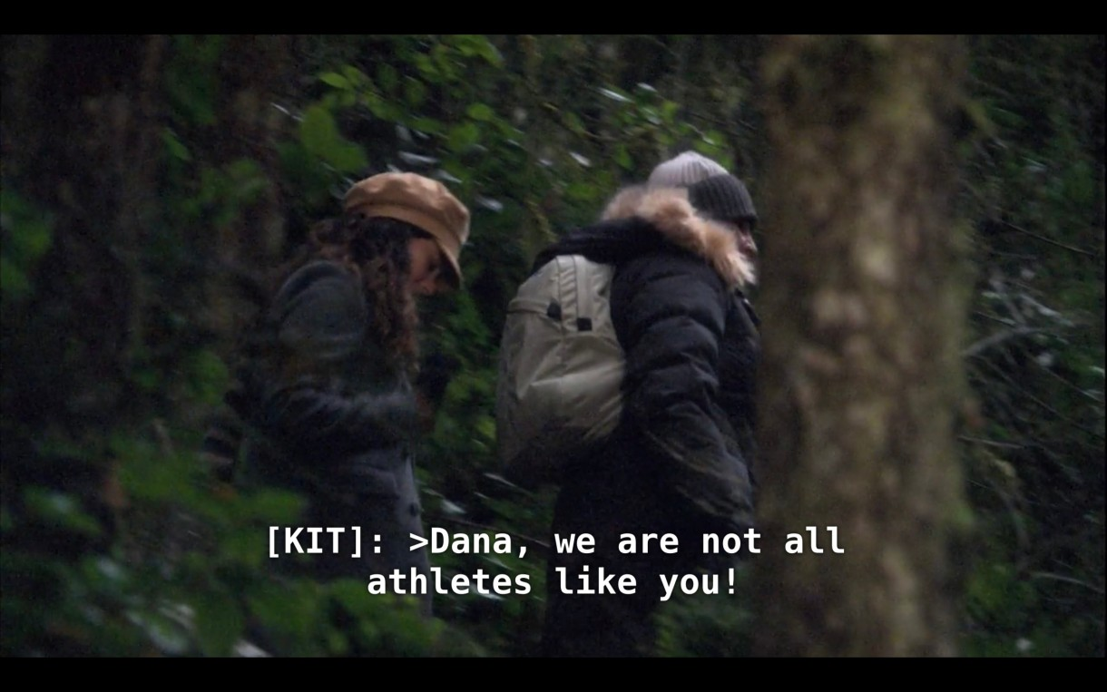 """Kit and Jenny are hiking next to each other through a forest. Kit says, """"Dana, we are not all athletes like you!"""""""