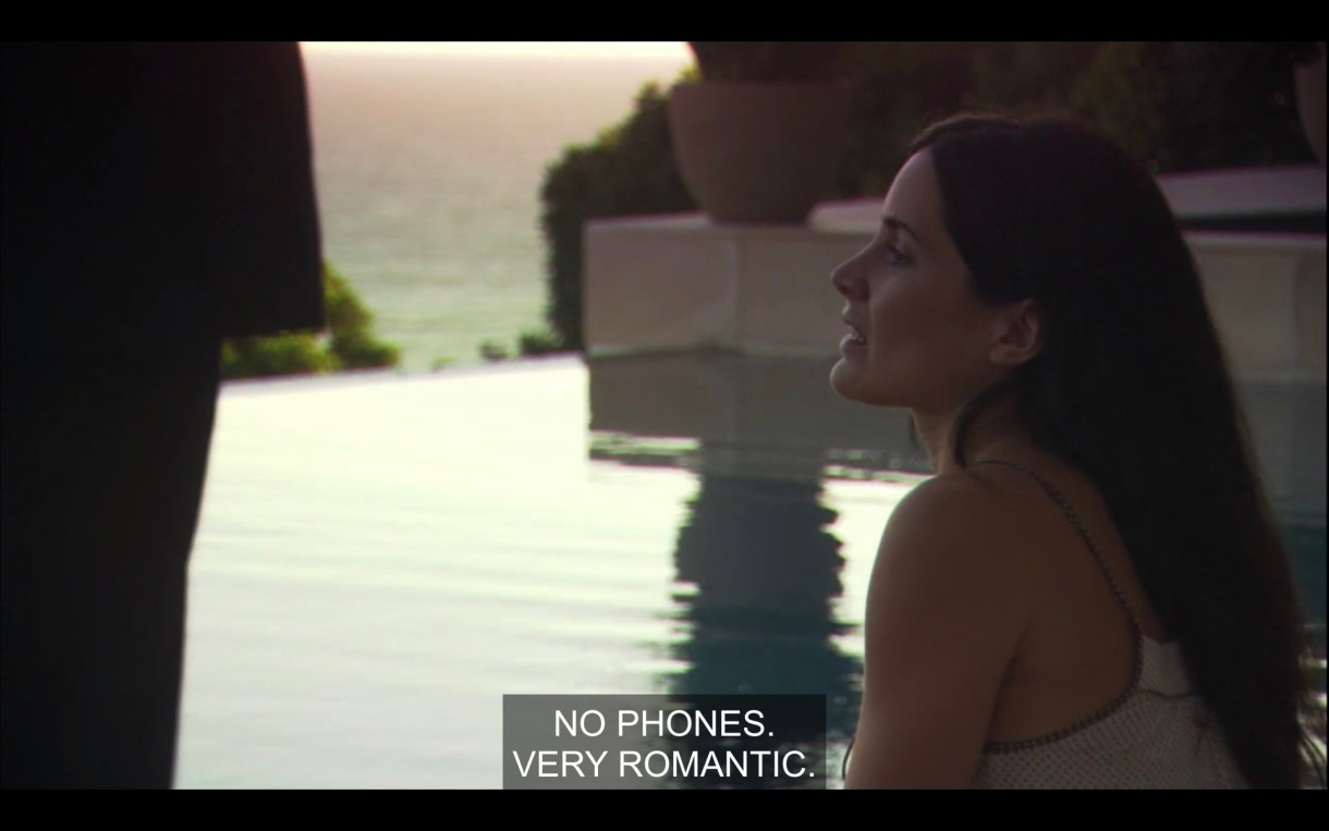 """Helena sitting at her infinity pool talking to her business manager. She says """"no phones, very romantic."""""""