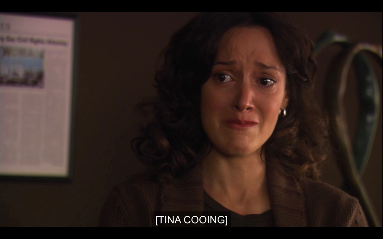 Bette crying in Joyce's office. Caption reads: [Tina Cooing]