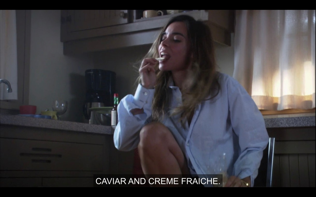 "Claude licks the lid of a yogurt, subtitle says ""Caviar and Creme Fraiche"""