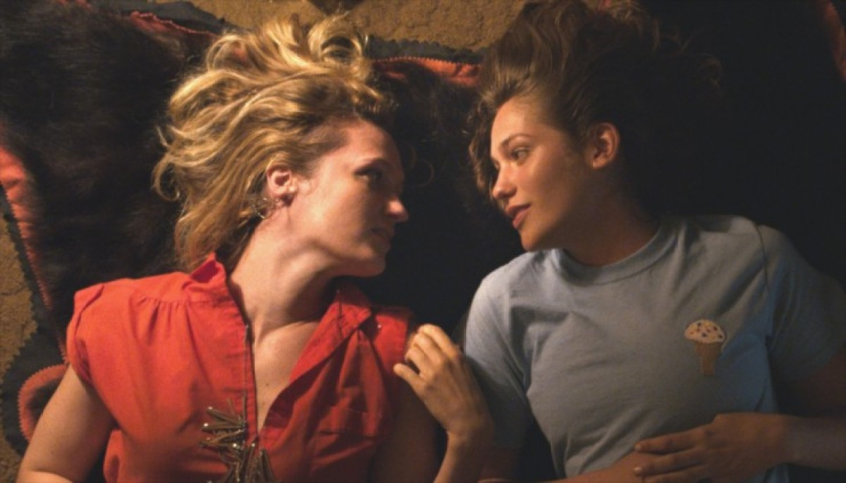 A screenshot of A.W.OL. where two women lay in bed. This is one of the lesbian movies available for streaming on Hulu.