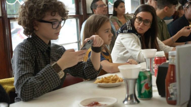 Sam her kids at a diner