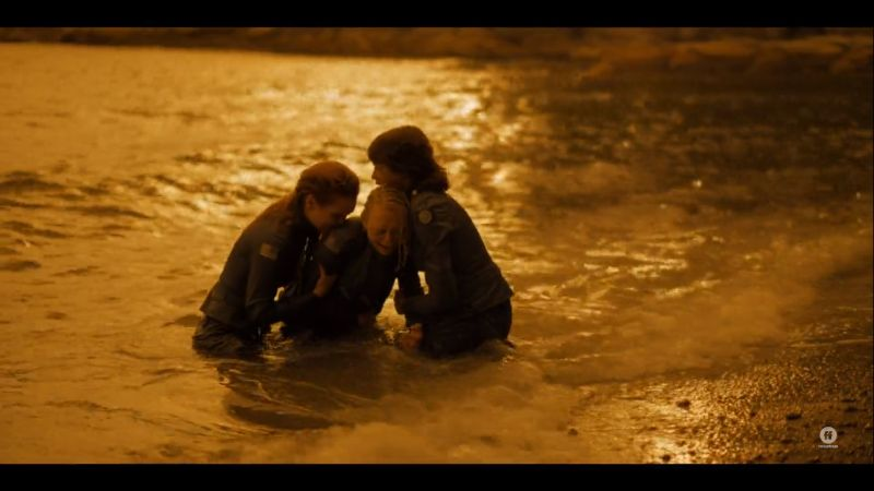 the girls hold each other and cry in the ocean