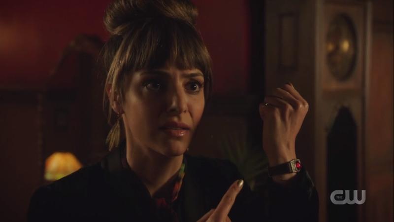 zari points to her fist/wrist
