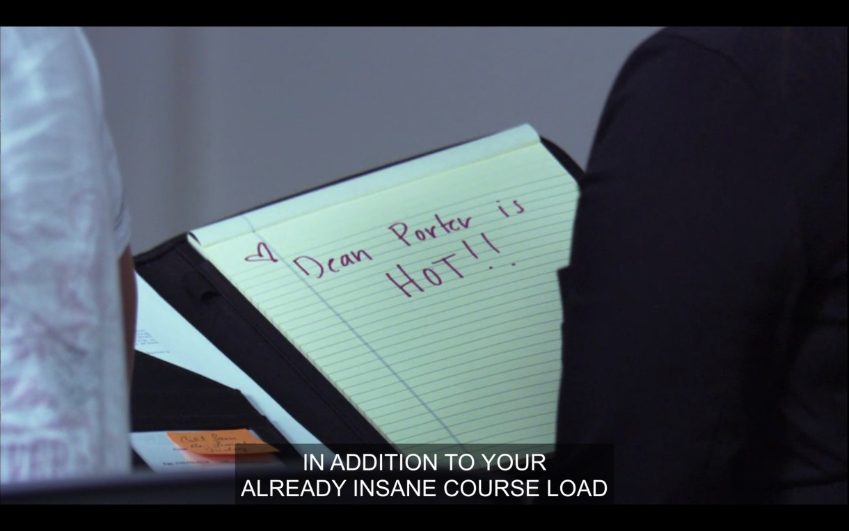 """A yellow legal pad with """"Dean Porter is HOT!!"""" written in a purple marker. Of screen, Bette says, """"In addition to your already insane course load."""""""