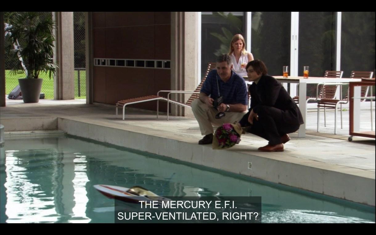"Max and his boss are driving a remote control boat in a pool. Max says, ""The Mercury E.F.I. Super ventilated, right?"""