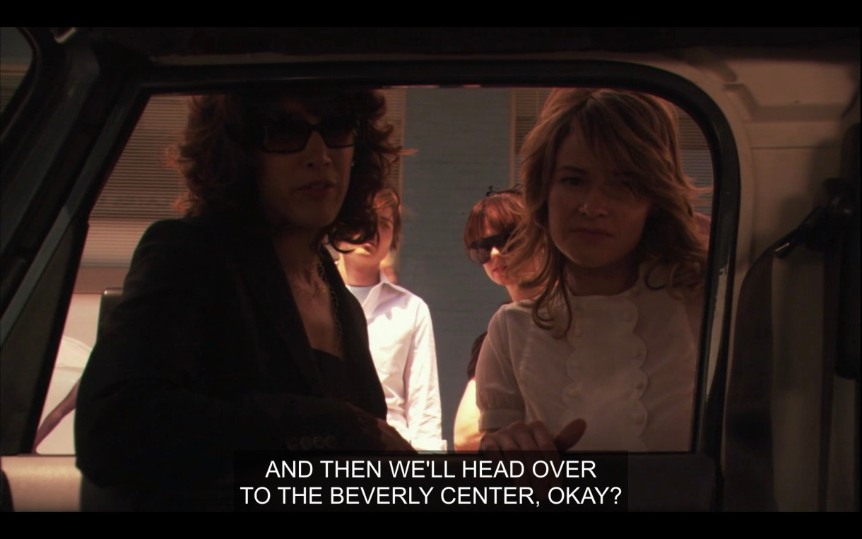 """Bette, Alice, Jenny, and Max look into the window of Shane's car to talk to her. Bette says, """"And then we'll head over to the Beverly Center, okay?"""""""
