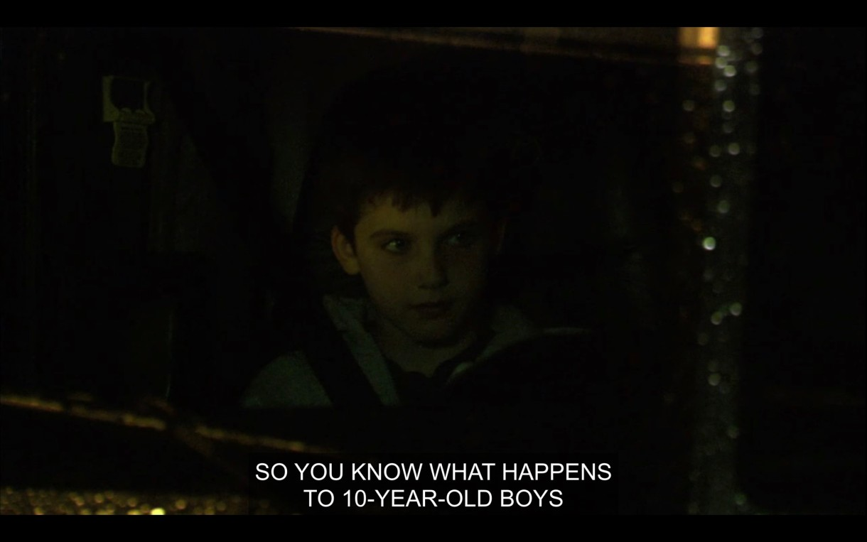 """Shay is hitch-hiking and riding in a semi-truck. The driver, off screen, says to him, """"So you know what happens to 10-year-old boys when they run away, don't you?"""""""
