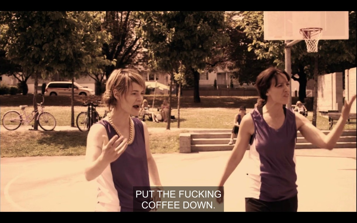 "Alice and Bette on the basketball court. Alice yells at Jenny (who is off screen), ""Put the fucking coffee down!"""