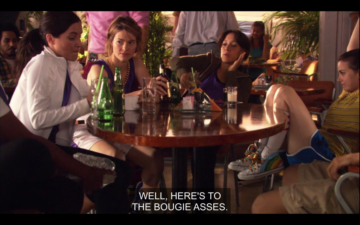 "Helena, Alice, Bette, and Jenny sit around a round table at The Planet after the basketball game. Bette raises her glass for a toast and says, ""Well, here's to the bougie asses."""