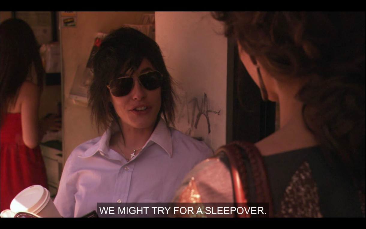 """Shane in a blue button up and aviator sunglasses. """"We might try for a sleepover."""""""