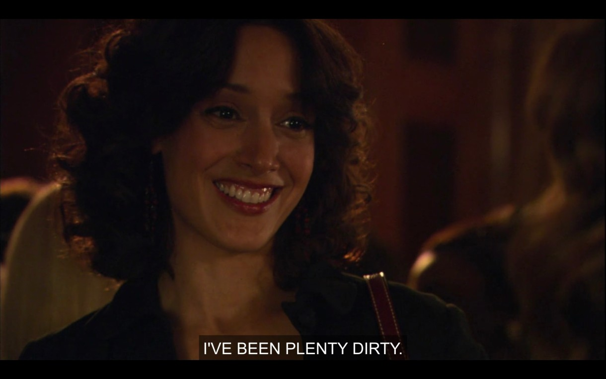 """Bette (in a black blazer) smiles and says, """"I've been plenty dirty."""""""