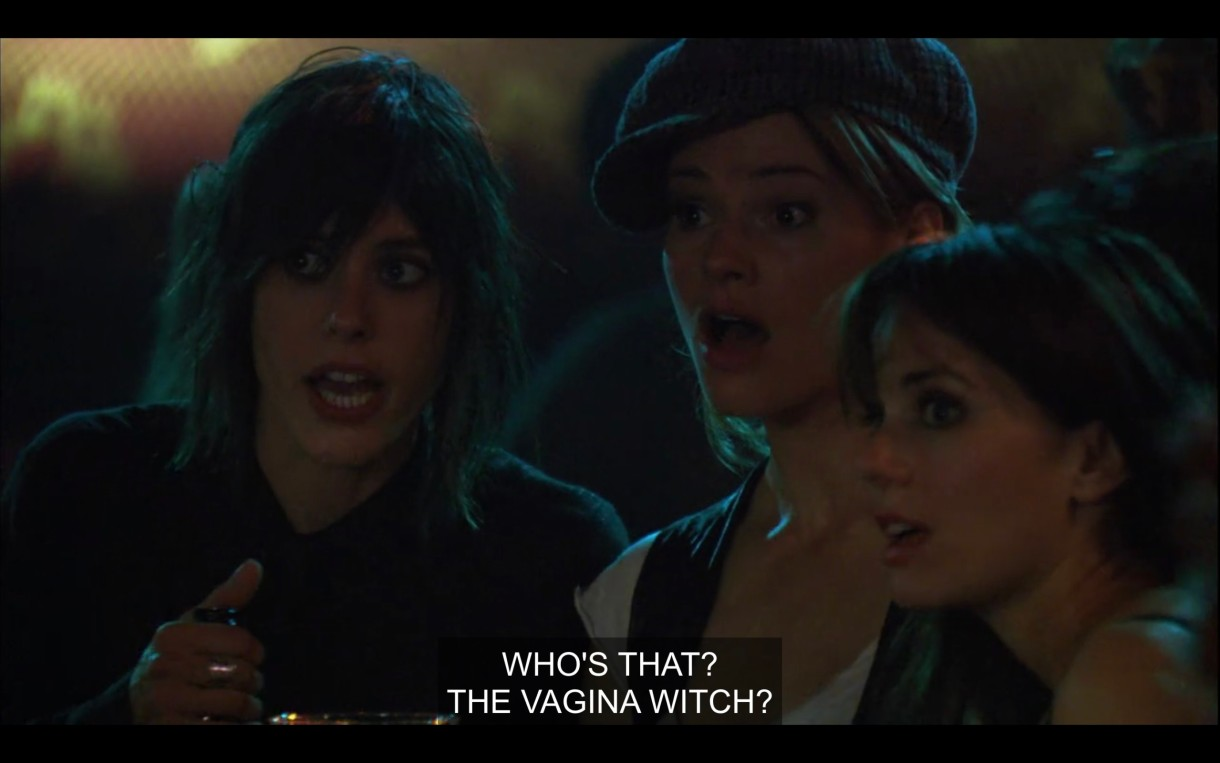 """Shane, Alice, and Jenny stand next to each other in a bar with their jaws dropped. """"Who's that? The vagina witch?"""""""