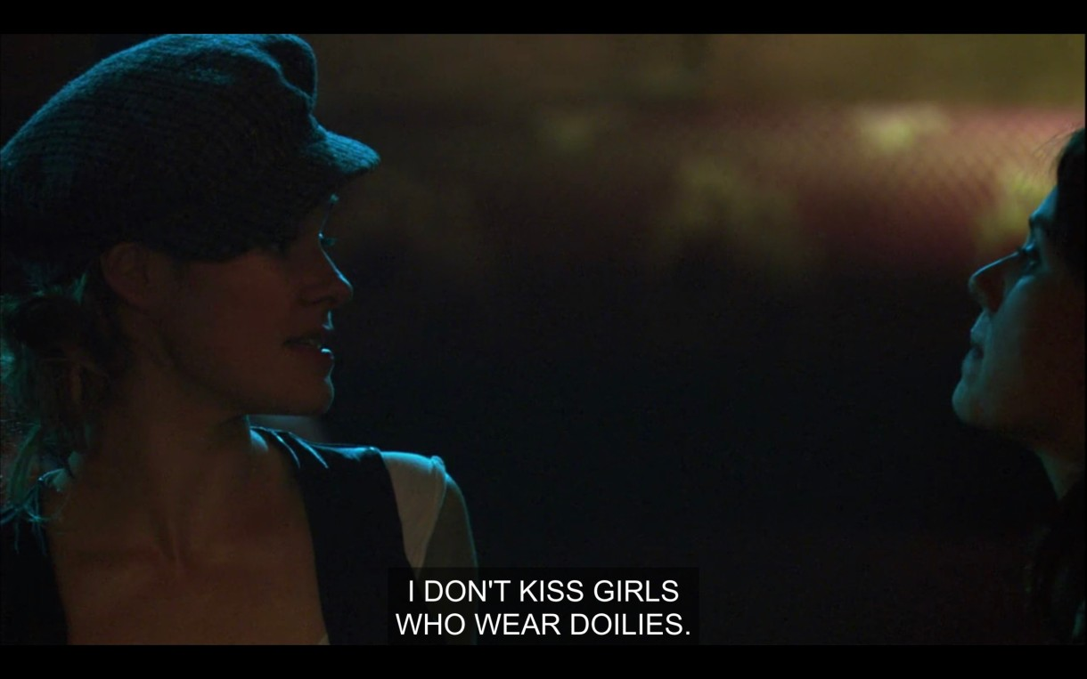 """Alice and Jenny look at each other contentiously. """"I don't kiss girls who wear doilies."""""""