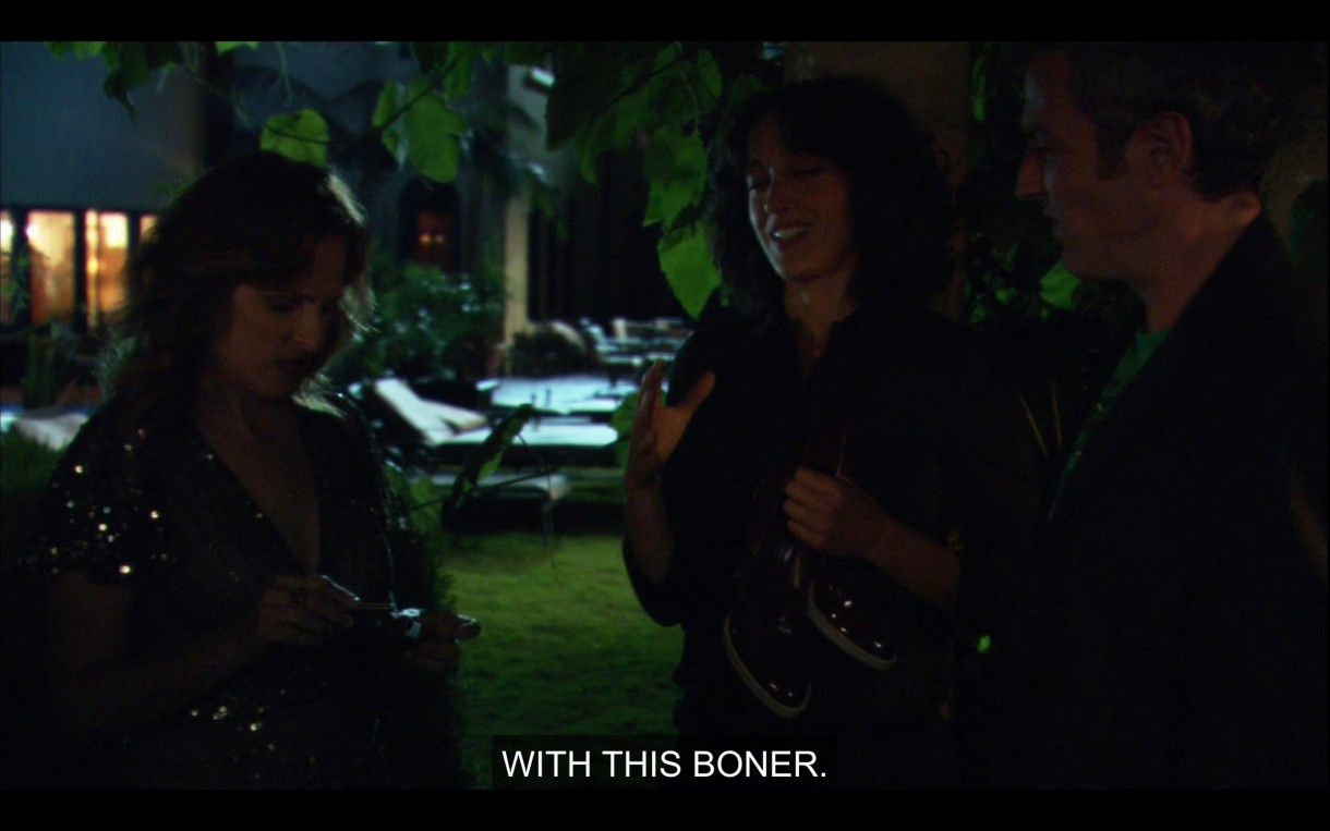 """Jodi, Bette, and Tom stand outside in the dark in a semi-circle. """"With this boner."""""""