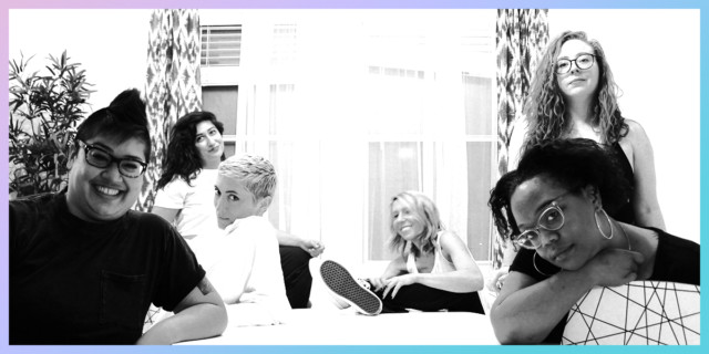 The Senior Team looks cool, smiles, hangs out around a table. Kamala and Carmen are in the foreground, Kamala grinning and Carmen looking thoughtful. Behind them, Laneia offers up some sass, Rachel a deep look, Sarah smiles behind and a slightly blurred and moving Riese laughs. The image is black and white.