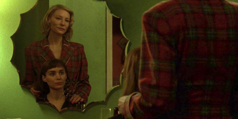 "Still from ""Carol"" of Carol and Therese looking in the mirror together"