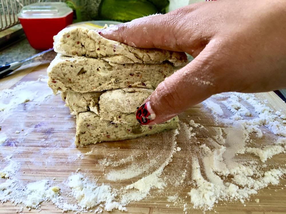 hand smashing pile of dough