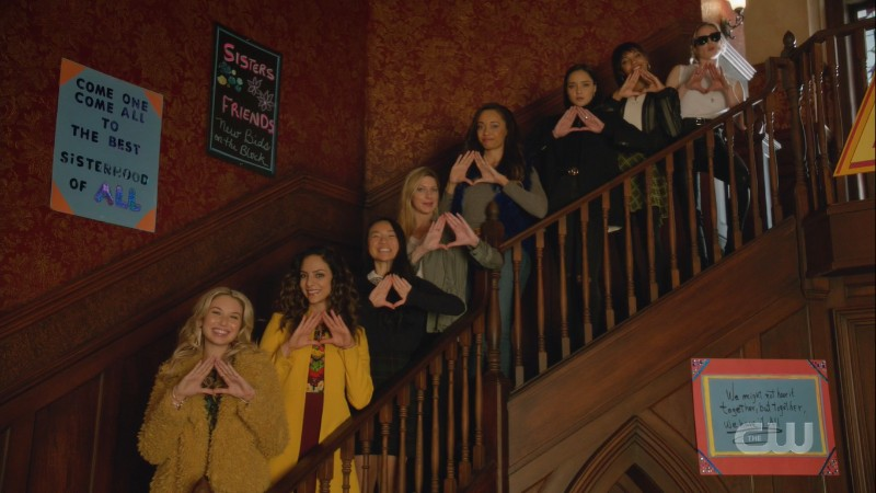 the Deltas make a triangle with their hands