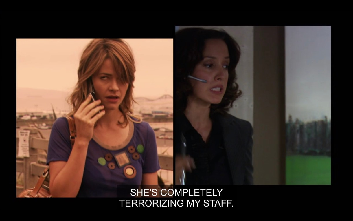 """Side by side visual of Alice and Bette talking to each other on the phone. Alice is wearing a purple top and is holding her cell phone to her ear. Bette is in a black blazer and talking into a headset. """"She's completely terrorizing my staff."""""""