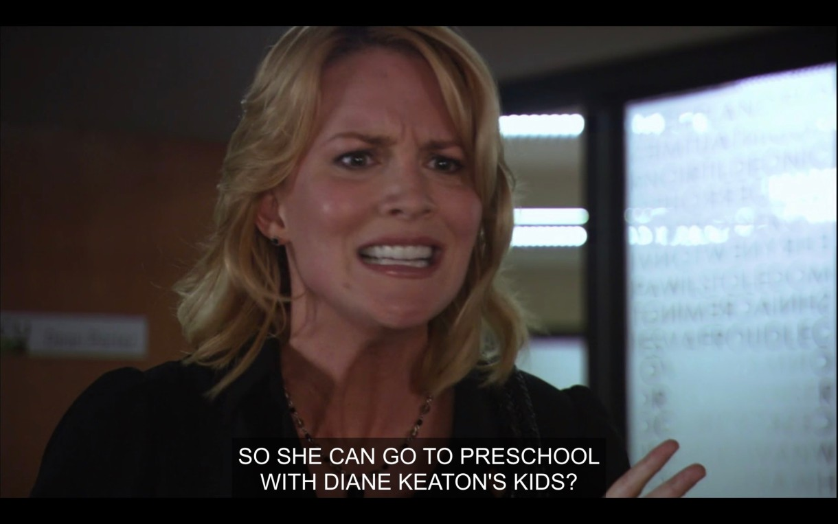 """Tina looks angry and is standing in Bette's office. She says, """"So she can go to preschool with Diane Keaton's kids?"""""""