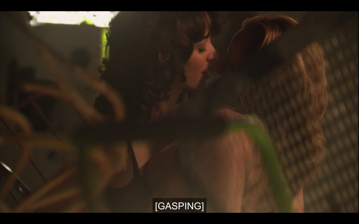 """Bette and Jodi making out, both in their bras. Subtitles read, """"[Gasping]"""""""