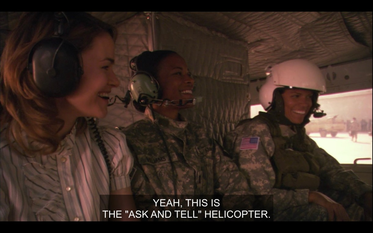 "Inside a helicopter: Alice, another soldier and Tasha. Everyone is laughing and happy. Caption reads 'Yeah this is the ""ask and tell"" helicopter."""