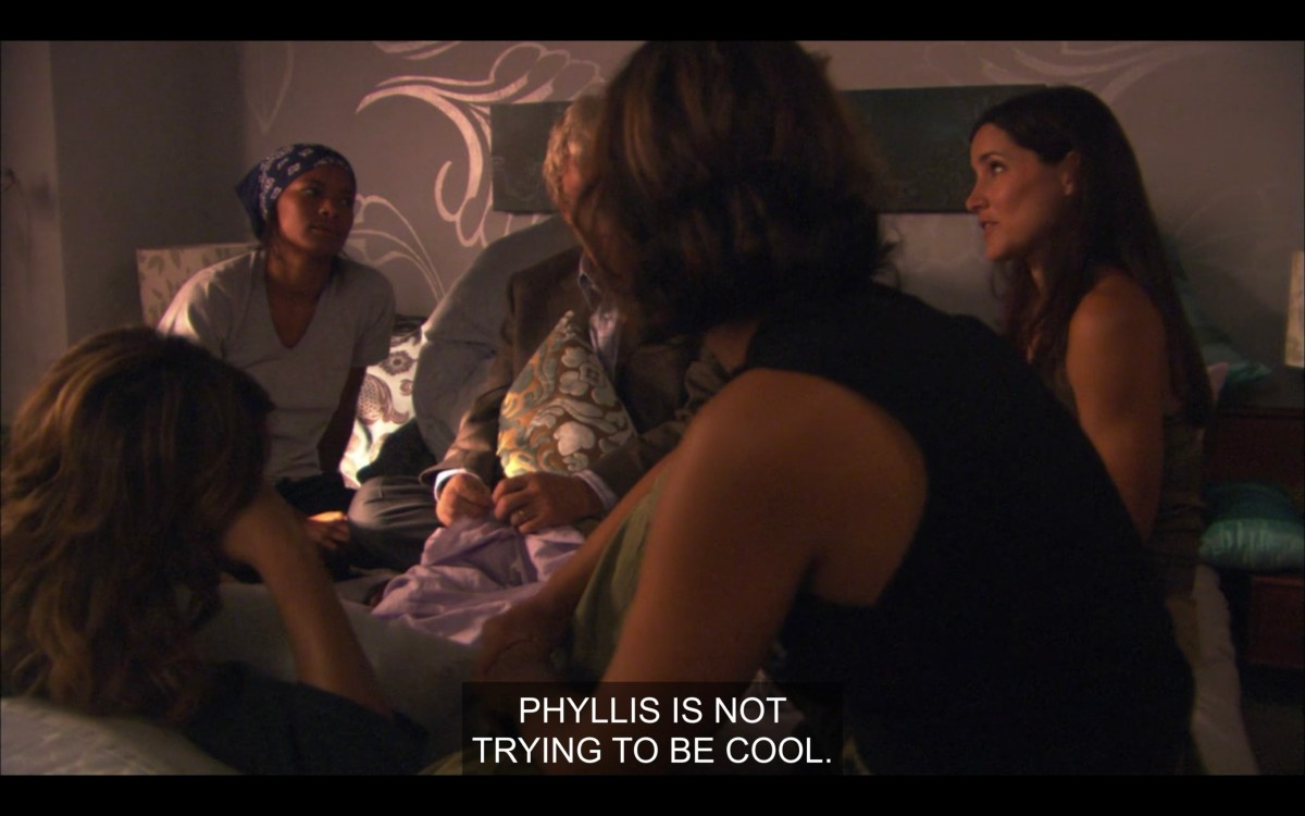 """Alice, Tasha, and Helena sitting in Alice's bed. Helena says, """"Phyllis is not trying to be cool."""""""